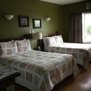 Room 6 with our lovely quilts for the summer. Spacious enough for a family or just 2 traveling companions.