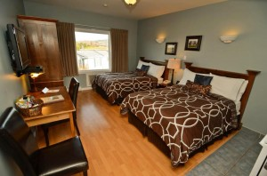Book room #6 at the Evergreen Inn and stay in our Xavier room, complete with local pictures, blue and white accessories and all amenities you will need